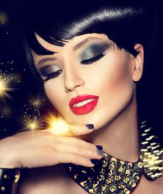 stock photo of gothic hair  - Beauty Fashion Model Girl with bright Makeup and golden Accessories - JPG