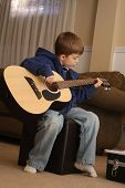 Guitar Playing Boy