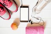 Red Sneakers With Towel, Peach, Bottle With Water, Smartphone With Empty Screen With Headphones On W poster