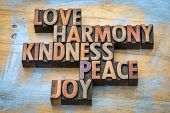 love, harmony, kindness, peace and joy - inspirational word abstract in vintage letterpress wood typ poster