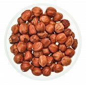 Unshelled Hazel Nuts In A Glass Bowl