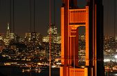 picture of golden gate bridge  - A shot of the famous landmark Golden Gate Bridge with San Francisco city lights in the background - JPG