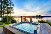 Awesome Water View With Hot Tub In Summer Evening. poster