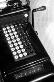 foto of yesteryear  - This is an image of a vintage adding machine with ledger paper and ledger paper - JPG