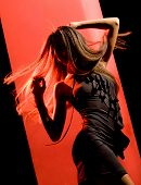 image of little black dress  - Outline of moving female figure in little black dress performing dance - JPG