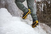 Pair Of Alpinist Boots In Crampons