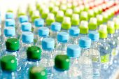 stock photo of blue things  - Image of many plastic bottles with water in a shop - JPG