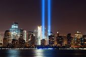 New York City downtown urban architecture at night and September 11 tribute light poster