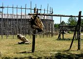 pic of iroquois  - the historical iroquois village is built from typical for them long houses - JPG