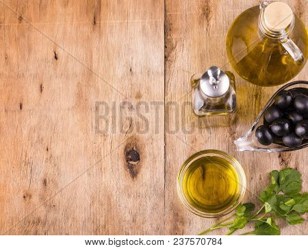 poster of Olive Oil. Bottle Of Virgin Olive Oil. Olives And Healthy Olive Oil Bottles And Cup With Parsley On