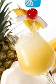 image of pina-colada  - Pina Colada cocktails surrounded by tropical fruits - JPG