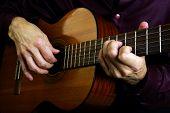 Playing An Acoustic Guitar. Closeup. Guitarist Hands And Guitar Close Up. poster