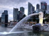 SINGAPORE-DEC 29: The Merlion fountain and Singapore skyline on Dec. 29, 2010. Merlion is an imaginary creature with a head of a lion and the body of a fish and is often seen as a symbol of Singapore