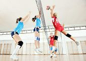 stock photo of volleyball  - volleyball game sport with group of young beautiful  girls indoor in sport arena - JPG