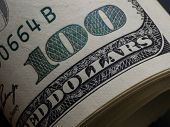 Macro Shot Of A 100 Dollar. Dollars Closeup Concept. American Dollars Cash Money. One Hundred Dollar poster