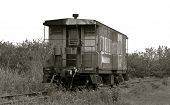 picture of caboose  - Black and White picture of a Caboose outside of the city - JPG