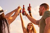 Cheerful Hilarious Young Friends Raising Hands With Beer Bottles And Cheering For Perfect Vacation W poster