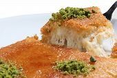 stock photo of baklava  - Kunefe, kadayif and made cheese and served hot as a Turkish dessert