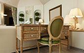 interior luxury apartment, comfortable suite, wooden desk