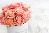 Beautiful Pink Roses In A Round Box. Peach Roses In A Round Box. Roses In A Round Box On A White Woo poster