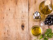 Olive Oil. Bottle Of Virgin Olive Oil. Olives And Healthy Olive Oil Bottles And Cup With Parsley On  poster