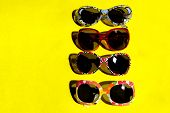 Travel, Vacation, Summer And Sale Background. Close-up Shot Of Sunglasses. Sunglasses On Yellow Back poster