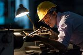 Mechanic Engineer Turner Miller Verifies The Accuracy Of Manufacturing Steel Parts With A Scale The  poster