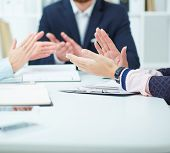 Close-up Image Of Business People Clapping Hands. Business Seminar Concept. poster