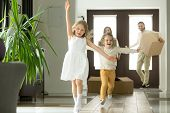 Excited Funny Kids Boy And Girl Running Inside Luxury Big Modern House On Moving Day, Cute Children  poster