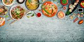 Various of asian meals on rustic background , top view , place for text. Asian food concept. poster