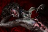 Man With Nude Torso Holds Red Plush Soft Heart Toy On Chest, Dark Background. Depression And Brake U poster