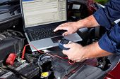 picture of internal combustion  - Hands of mechanic working in auto repair shop - JPG