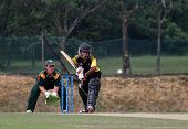 PUCHONG, MALAYSIA - SEPT 24: Tom Kimber, Guernsey watches Faris Lee of Malaysia bat in this Pepsi ICC World Cricket League Div 6 finals at the Kinrara Oval on September 24, 2011 in Puchong, Malaysia.