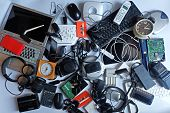 Pile Of Used Electronic Waste On White Background, Reuse And Recycle Concept, Top View poster