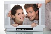 Couple in a television screen