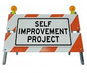 Self Improvement Project words on a road construction barrier to communicate that one is undergoing