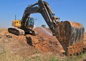 stock photo of excavator  - Excavator on construction site with big shovel.