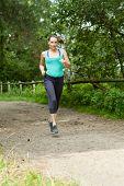 Woman Running Through A Forest