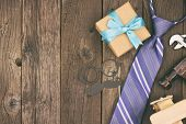 Fathers Day Side Border Of Gifts, Tie And Decor On A Rustic Wood Background. Top View, Vintage Styli poster