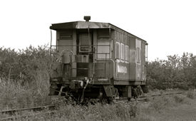 stock photo of caboose  - Black and White picture of a Caboose outside of the city - JPG