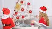 Children Decorating Christmas Tree Together. Siblings Busy Decorating. Boy And Girl Decorating Tree. poster