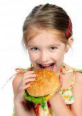 Постер, плакат: Маленькая девочка ест бутерброд изолированные на белом фоне