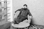 Tired Businessman. Brutal Businessman Relaxing At Workplace. Bearded Businessman Having Break For Re poster