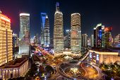 night view of illuminated Lujiazui skyline and Ring Road Circular Footbridge, Shanghai, China poster