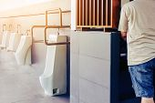 Clean And Modern Public Men Toilet With Friendly Design For People With Disability Or Elderly With S poster
