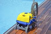 Pool Cleaner During His Work. Cleaning Robot For Cleaning The Botton Of Swimming Pools. Automatic Po poster
