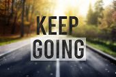 Quote Keep Going Over Road In Autumn Forest. Motivation Concept poster