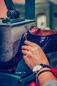 Experienced Shoemaker  Using Special Machine Tool For Making A Shoes poster