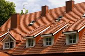stock photo of gabled dormer window  - Red tile roof and gabled dormer windows in Palanga resort of Lithuania - JPG