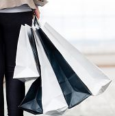 Woman holding shopping bags at the mall while walking